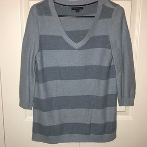 V-neck blue striped sweater with 3/4 sleeves.